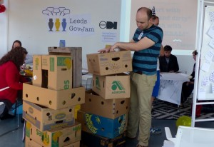 Tom building a prototype using cardboard boxes