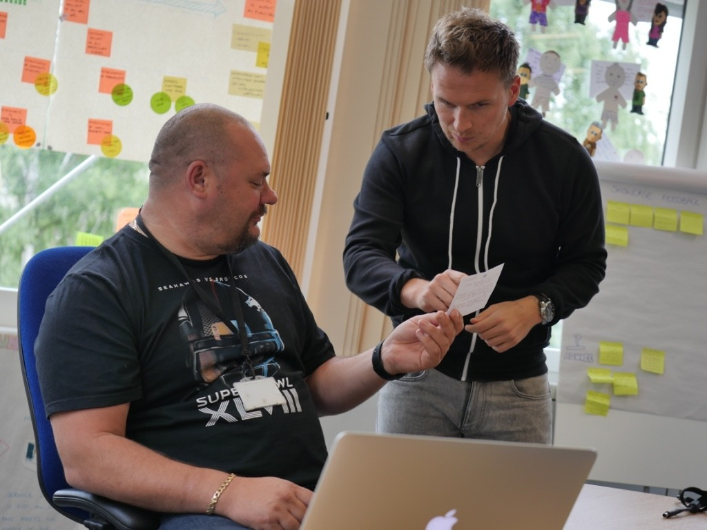 Story card discussion between Phil and a Secure Comms colleague