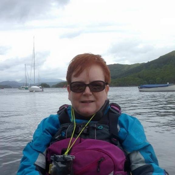 Helen Carr on the water in a kayak