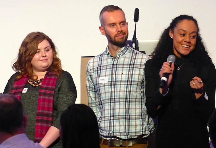 Colleagues on stage at a recent event