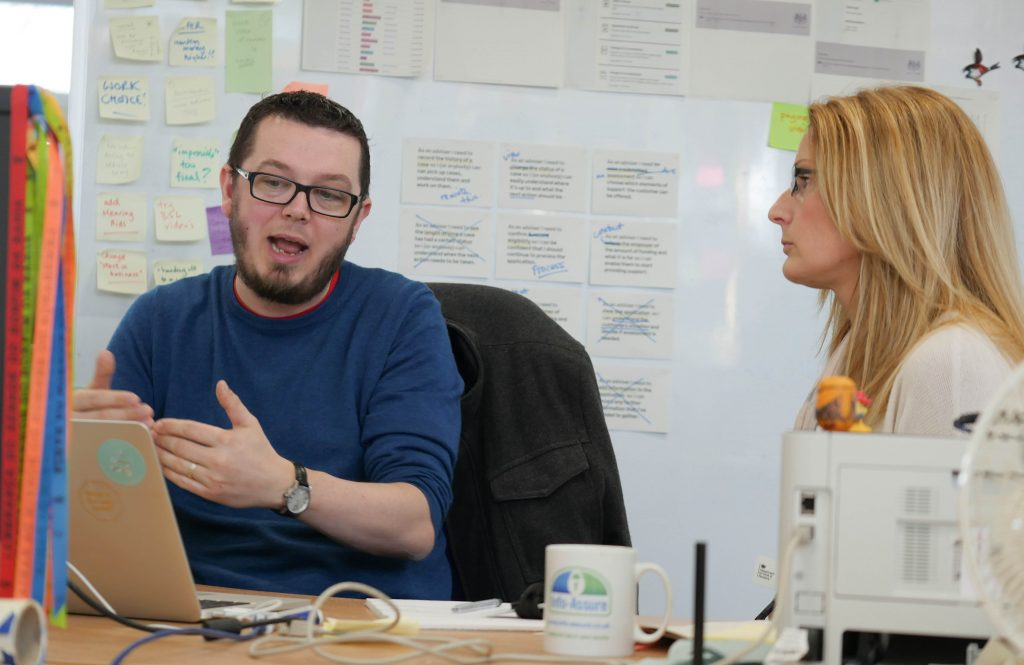 Tom Morgan in DWP's Leeds Transformation Hub with a colleague