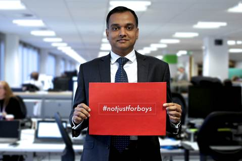 Mayan Prakash holding Not Just for Boys placard