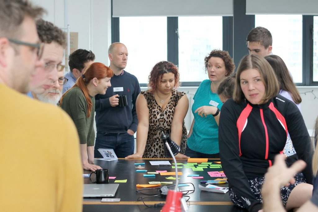 Emma (right) and the team share ideas at GovJam 2016