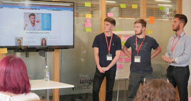 Lewis (right) and the other interns show the video they created as part of their internship programme