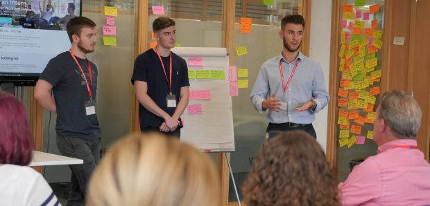 Lewis (right) delivers a presentation during his internship