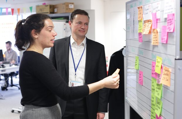 Adrian Atley and Alice Carter at a kanban