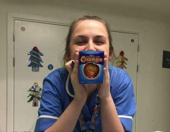 A nurse holds up her chocolate orange