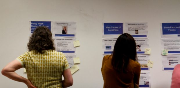 Participants look at the evidence wall during the workshop