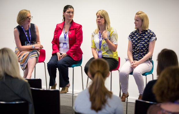 Sue Griffin takes part in a Q&A session with 3 other women at a conference
