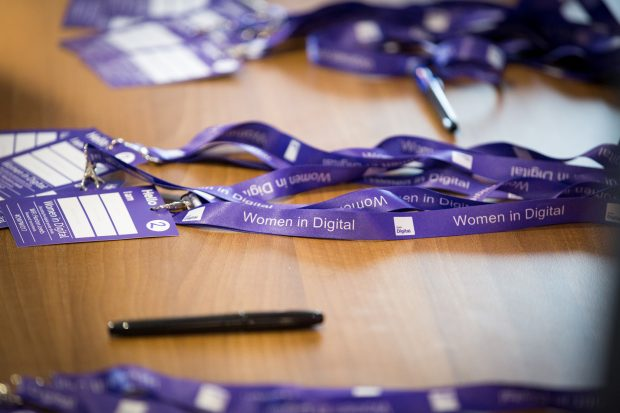 Women in Digital event lanyard on a desk