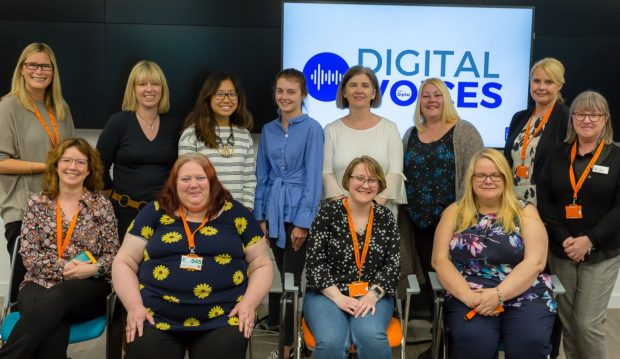 The 9 Digital Voices in a group photograph