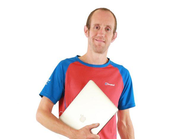 Steve Brooks holding a computer