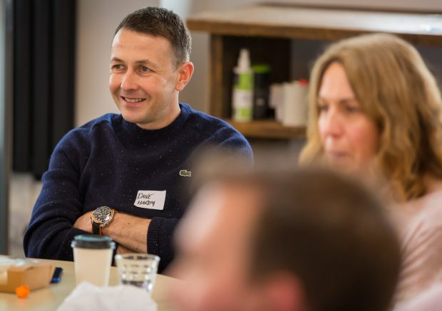 DWP Digital product owner Dave Hardy and two colleagues listen to talks at Product People North