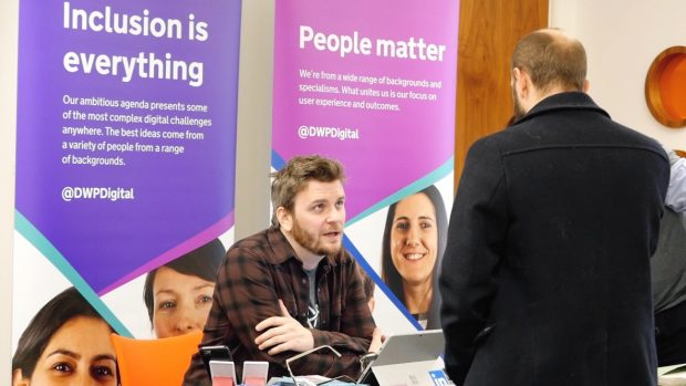 Peter Sweeney discussing recruitment opportunities with someone at the recent Hack the North 2.0 event