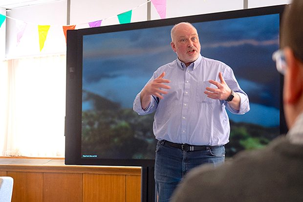 Simon McKinnon addresses colleagues during a stand-up at DWP Digital