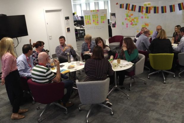 Jude Eccles leads a workshop with 14 colleagues around two tables