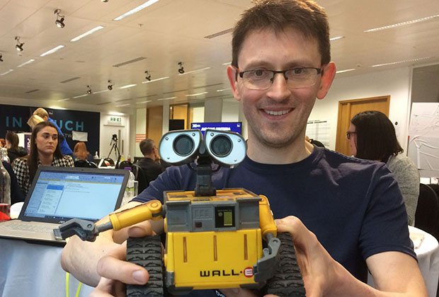 Andy tyack with his team mascot a Wall-E toy