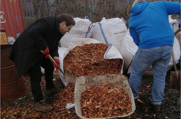 Andrew and a colleague shovelling wood chip for the new paths