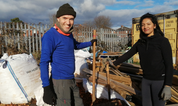 Image of Oliver and colleague Damine holding shovels