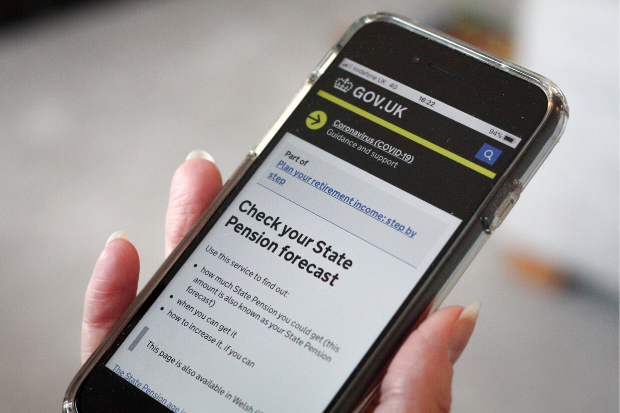 A user views the Check your State Pension forecast page on gov.uk on a mobile phone