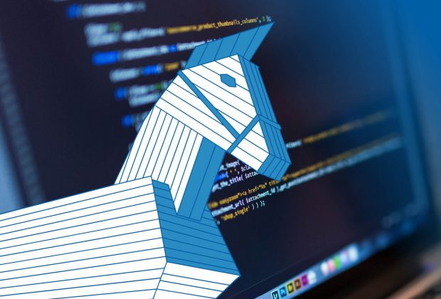 A graphic of a wooden Trojan horse in front of a computer screen displaying computer code