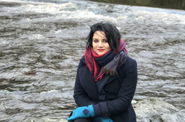 Photo of Swetha sat by a river