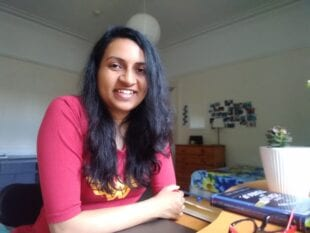 Head and shoulders shot of Shivangi Das working from home